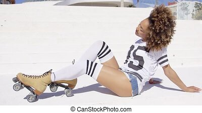 Female wearing roller skates posing - Smiling female wearing...