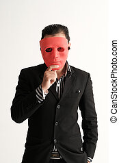 Business man put on red mask on white background indicating...