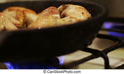 Chicken fried in a pan close up view