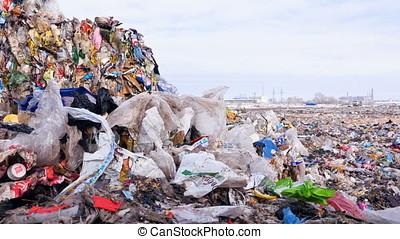 Big piles of garbage. Plastic, packages, polyethylene in a...