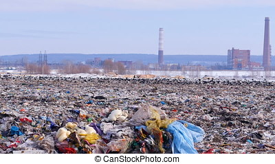 Pan of a big piles of garbage. Plastic, polyethylene in a...