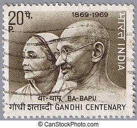 Gandhi and his wife Kasturba - INDIA - CIRCA 1969: A stamp...