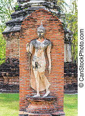 Sukhothai historical park - Ancient Buddha Statue in...