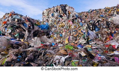 Enviroment pollution concept. Garbage dump. Close up. Dolly...