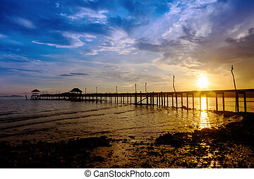 Wooded bridge to the sea between sunset at Koh Kood, Trat,...