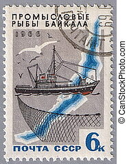 Trawler, net and map of Lake Baikal - USSR - CIRCA 1966: A...