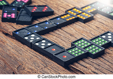 Domino gaming pieces - Dominoes. Dominoes is a game played...