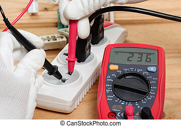 using the multimeter - electrician using the digital...