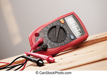 red digital multimeter - digital multimeter or multitester...