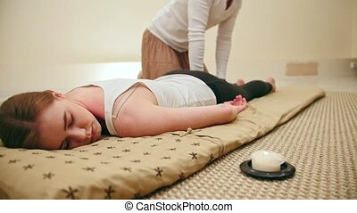 Thai traditional massage - therapy in thailand - stretching of the legs