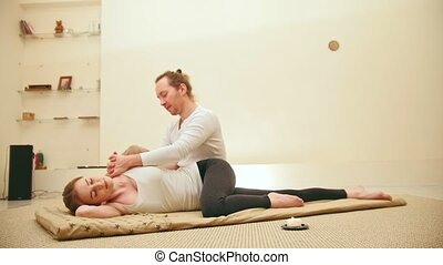 Traditional thai massage therapy for caucasian female - shoulders