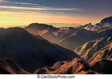 Alpi Apuanei mountains and marble quarry view at sunset....