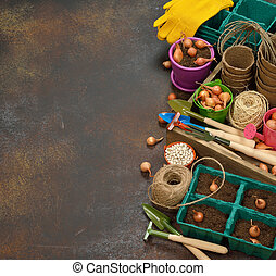 Garden tools on a brown background