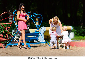 Mothers playing with children