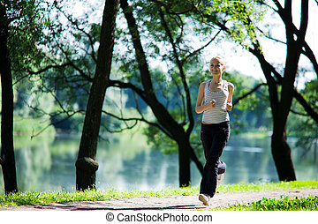 woman Running - Young woman Running looking straight summer...