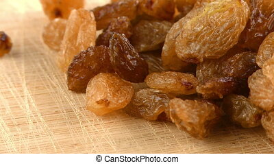 Raisins on Wooden Background