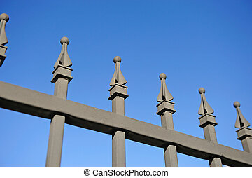 metal fence over the blue sky background