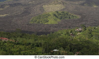 Foot of the Batur volcano. Aerial view from Kintamani. Lava...