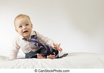 Cute baby boy with a tie