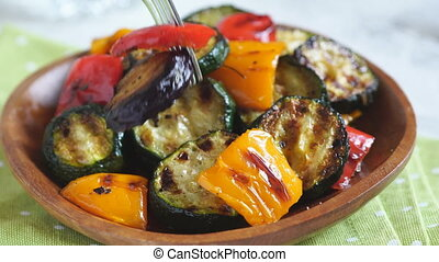 Grilled vegetables salad with zucchini, eggplant, onions,...