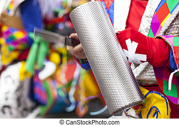 Performer playing the Güira at Carnival parade