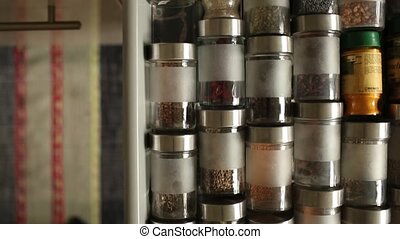 Spices in glass jars cutlery drawer opens overhead view