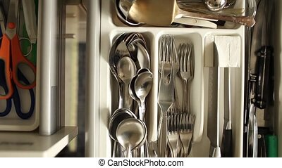 flatware cutlery drawer opens overhead view