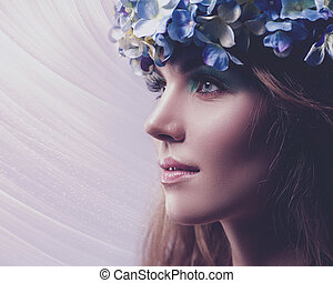 Spring Beauty. Female portrait with floral crown and beauty natural bokeh