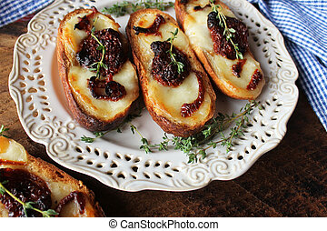 Sandwich with mozzarella sundried tomatoes and thyme on...