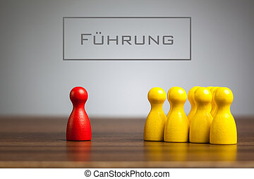 Fuehrung, German text for Leadership text over single pawn figuring in front of many