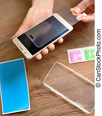 Installing safety glass on smartphone - Kit of installing...