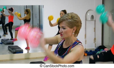 Mature women exercising together at the fitness gym