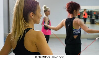 Young attractive women stretching in aerobics class