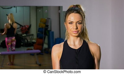 Portrait of strong woman doing body building exercising with...