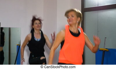 Women jogging at the gym using trampoline