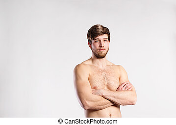 Handsome shirtless fitness man, arms crossed. Studio shot. -...