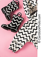 The Black and white rubber boots or gardening boots on pink...