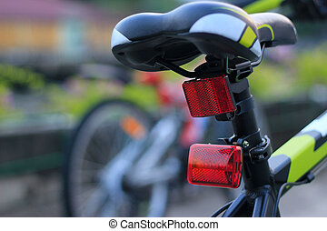 Back lights bicycle on street background