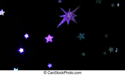 colorful small stars on a black