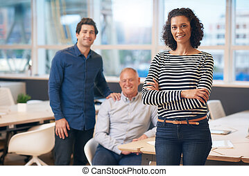 Confident businesswoman standing in an office with...