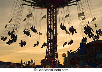 Old Fashion Carousel at Sunset - Silhouette of an Old...