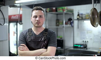 Portrait of a chef in a restaurant in the kitchen