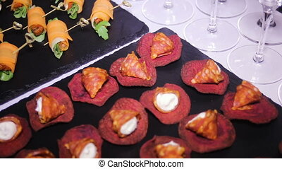 colorful canapes are on the black tray