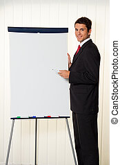 Successful businessman with a flipchart for presentation -...