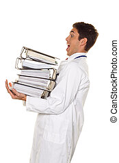 Doctor on stress with stacks of files. Bureaucracy in the...