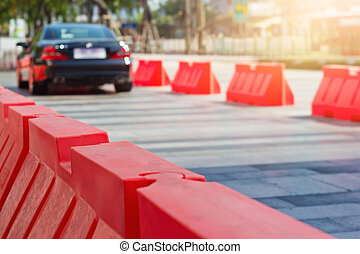 Traffic plastic barriers and pylon on the road