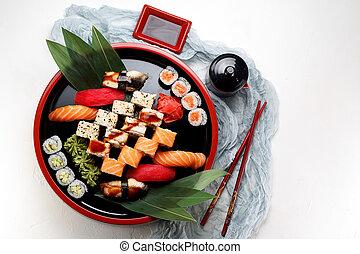Sushi nigiri set on ice over white stone background