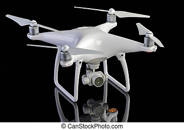 Studio photo of a drone aircraft - White drone against black...