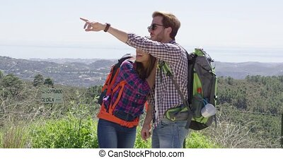 Two young people in mountains - Young female and man smiling...