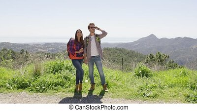 Young couple in mountains - Couple hiking in mountains in...